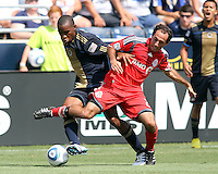 Danny Mwanga #10 of the Philadelphia Union tangles with Nick LaBrocca #21 of Toronto FC during an MLS match at PPL stadium in Chester, PA. on July 17 2010. Union won 2-1.