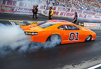 Oct 28, 2016; Las Vegas, NV, USA; NHRA pro stock driver Bo Butner with his Dukes of Hazzard themed car with Confederate Flag on the roof does a burnout during qualifying for the Toyota Nationals at The Strip at Las Vegas Motor Speedway. Mandatory Credit: Mark J. Rebilas-USA TODAY Sports