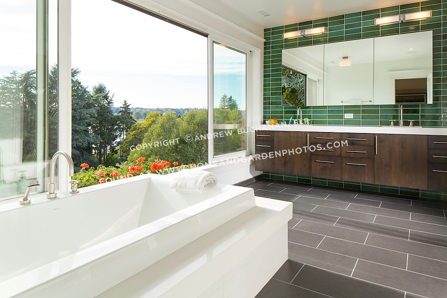 Master bathroom with a wall of bright green subway tile and large sliding windows that allow access to flower-filled window boxes. This image is available through an alternate architectural stock image agency, Collinstock located here: http://www.collinstock.com