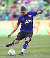 Manchester United forward Federico Macheda passes the ball during play against the Seattle Sounders FC at CenturyLink Field in Seattle Wednesday July 20, 2011. Manchester United won the match 7-0.