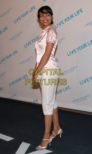 "ROSARIO DAWSON.American Eagle Outfitters' ""Live Your Life Contest"" winners at the Union Square flagship store in Manhattan, New York, New York..July 27th, 2005  .Photo Credit: Patti Ouderkirk/AdMedia.full length white three quarter elngth cropped trousers white clutch purse pink silk satin blouse .www.capitalpictures.com.sales@capitalpictures.com.© Capital Pictures."