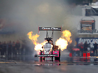 Oct 1, 2016; Mohnton, PA, USA; NHRA top fuel driver Clay Millican has an engine fire during qualifying for the Dodge Nationals at Maple Grove Raceway. Mandatory Credit: Mark J. Rebilas-USA TODAY Sports
