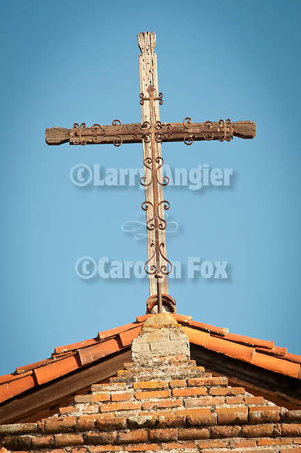 Rustic cross over the chapel entrance, Mission San Antonio de Padua, California.