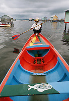 Dweller of stilt houses in Lake Maracaibo in Venezuela using his fishing boat for transportation.