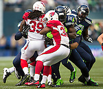 Arizona Cardinals running back Stephan Taylor (30) can't find any running room against Seattle Seahawks strong safety Kam Chancellor (31)at CenturyLink Field in Seattle, Washington on November 23, 2014. The Seahawks beat the Cardinals 19-3.   ©2014. Jim Bryant Photo. All Rights Reserved.