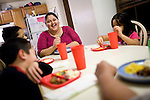 The Sawyer family eats dinner January 27, 2010 at their home in Sacramento, Calif. The Sawyer family receives $540/month in CalWORKs assistance from the state of California. Dennis is currently unable to work while recovering from cancer, and Sophia hasn't been able to find work. Gov. Arnold Schwarzenegger has proposed eliminating the CalWORKs program in an effort to balance the state's budget. CREDIT: Max Whittaker for The Wall Street Journal.CABUDGET