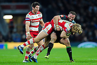 Billy Twelvetrees of Gloucester Rugby is tackled by Jamie Roberts of Harlequins. Aviva Premiership match, between Harlequins and Gloucester Rugby on December 27, 2016 at Twickenham Stadium in London, England. Photo by: Patrick Khachfe / JMP