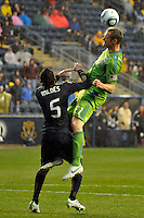 Nate Jaqua (21) of the Seattle Sounders FC heads the ball. The Philadelphia Union and the Seattle Sounders FC played to a 1-1 tie during a Major League Soccer (MLS) match at PPL Park in Chester, PA, on April 16, 2011.