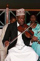 Zanzibar, Tanzania.  Taarab Musicians.  Culture Musical Club. Violin Player, wearing a traditional Zanzibari hat, a kofia.