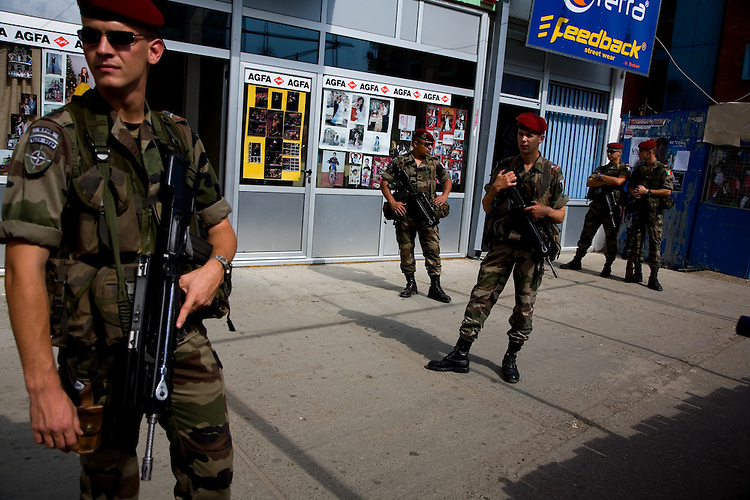 French KFOR soldiers patrolling in downtown...Mitrovica, Kosovo, Serbia