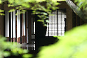 July 20, 2010 - Niiza, Japan - A house is seen through Heirinji's wood, part of the Rinzai temple of the Myoshin-ji branch located in Niiza city, Japan, on July 20, 2010. Visiting the temple is part of the 'True Japan Saitama - Zen Medidation and Buddhist Vegetarian Cuisine' tour, organized by the travel agency JTB for leisure travelers.