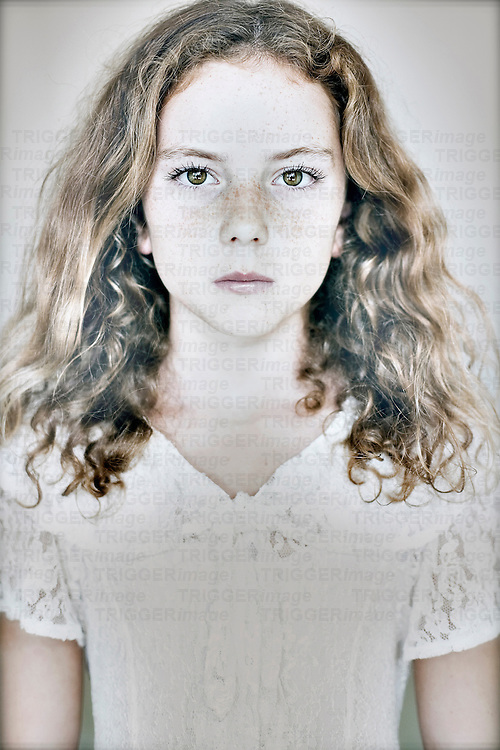Female youth looking at camera with freckles
