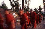 Young monks in a candlelight procession in memory of a monk who died.
