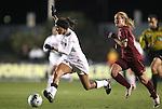 03 December 2010: Stanford's Christen Press (left) is chased by Boston College's Kate McCarthy (right). The Stanford University Cardinal defeated the Boston College Eagles 2-0 at WakeMed Stadium in Cary, North Carolina in an NCAA Women's College Cup semifinal game.