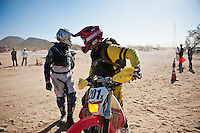201x motorcycle rider Derek Duncan leaves race mile 58 after rider change, 2012 San Felipe Baja 250, San Felipe, Baja California, Mexico.