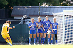 30 August 2013: A Duke wall of Mollie Pathman (24), Laura Weinberg (16), Kelly Cobb (9), and Kaitlyn Kerr (5) faces a free kick from Kennesaw State's Brittney Reed (27). The Duke University Blue Devils played the Kennesaw State University Owls at Fetzer Field in Chapel Hill, NC in a 2013 NCAA Division I Women's Soccer match. Duke won 1-0.