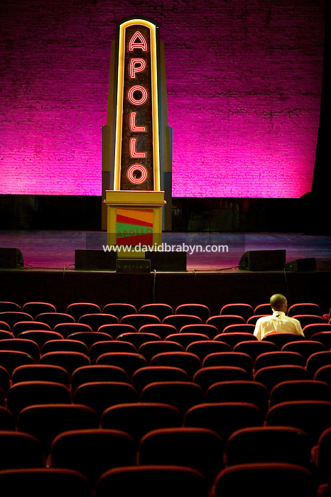 13 February 2006 - New York City, NY - An employee sits in one of the new seats at the Apollo theater in Harlem, New York City, USA, 13 February 2006. The famous theater, home of the Amateur Nights at The Apollo, is reopening with a renovated facade and new seats.