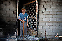 Panagiotis Mantas of the village of Platania stands in the doorway of his devastated home, destroyed by wild fires that swept across the Peloponnese;