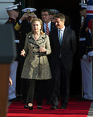 United States Secretary of State Hillary Rodham Clinton, left and U.S. Secretary of the Treasury Tim Geithner walk to their positions as U.S. President Barack Obama and first lady Michelle Obama prepare to welcome Prime Minister David Cameron of Great Britain and his wife, Samantha, to the White House in Washington, D.C. on Wednesday, March 14, 2012..Credit: Ron Sachs / CNP