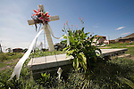 A white cross in front of a house foundation at 2435 Gordon in the 9th Ward of New Orleans one year after Hurricane Katrina. ...