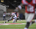 Ole Miss defensive end C.J. Johnson (10) sacks Central Arkansas' Wynrick Smothers (4) at Vaught-Hemingway Stadium in Oxford, Miss. on Saturday, September 1, 2012. (AP Photo/Oxford Eagle, Bruce Newman)..