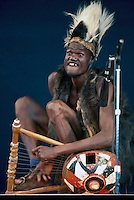 African Musician from Cote d'Ivoire (Ivory Coast) in West Africa performing on Stage in Traditional Costume - Member of Compagnons d'Akati (No Model Release Available)