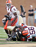 2 September 2006: Wake Forest's Micah Andrews (left) is thrown down by Syracuse's Chris Thorner (56). Wake Forest defeated Syracuse 20-10 at Groves Stadium in Winston-Salem, North Carolina in an NCAA college football game.