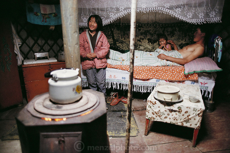 A small coal-burning stove heats the neighboring ger of Oyunsetseg's sister and her family on a snowy September weekend morning. Ulaanbaatar, Mongolia. Material World Project. The Regzen Batsuuri family lives in a 200 square foot ger (round tent built from canvas, strong poles, and wool felt) on a hillside lot overlooking one of the sprawling valleys that make up Ulaanbaatar, Mongolia.