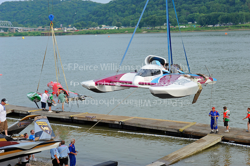 """The U-96 """"Spirit of Qatar"""" is lifted from the water following it's crash with the  U-1 """"Oh Boy! Oberto""""."""