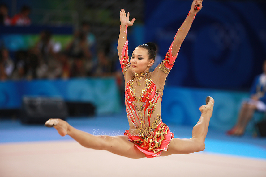 August 22, 2008; Beijing, China; Rhythmic gymnast Aliya Yussupova of Kazakhstan performs split leap with clubs on way placing 5th in All-Around final at 2008 Beijing Olympics..(©) Copyright 2008 Tom Theobald