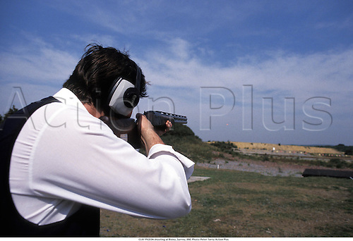 CLAY PIGEON shooting at Bisley, Surrey, 890. Photo: Peter Tarry/Action Plus...1989.clay pigeon shooting.trap .shotgun.shooter.gun.country pursuit