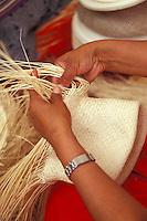 Close-p of woman's hands weaving A Panama hats or sombrero de paja toquilla in Ecuador, South America