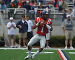Ole Miss' Randall Mackey (1) looks to pass at the  Grove Bowl in Oxford, Miss. on Saturday, April 16, 2011.