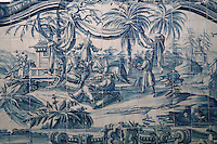 Chinese men, from scenes of the history of the monastery and the Siege of Lisbon in 1147, traditional blue and white azulejos tile scene, 18th century, in the Monastery of Sao Vicente de Fora, an Augustinian order monastery and church built in the 17th century in Mannerist style, Lisbon, Portugal. The monastery also contains the royal pantheon of the Braganza monarchs of Portugal. Picture by Manuel Cohen