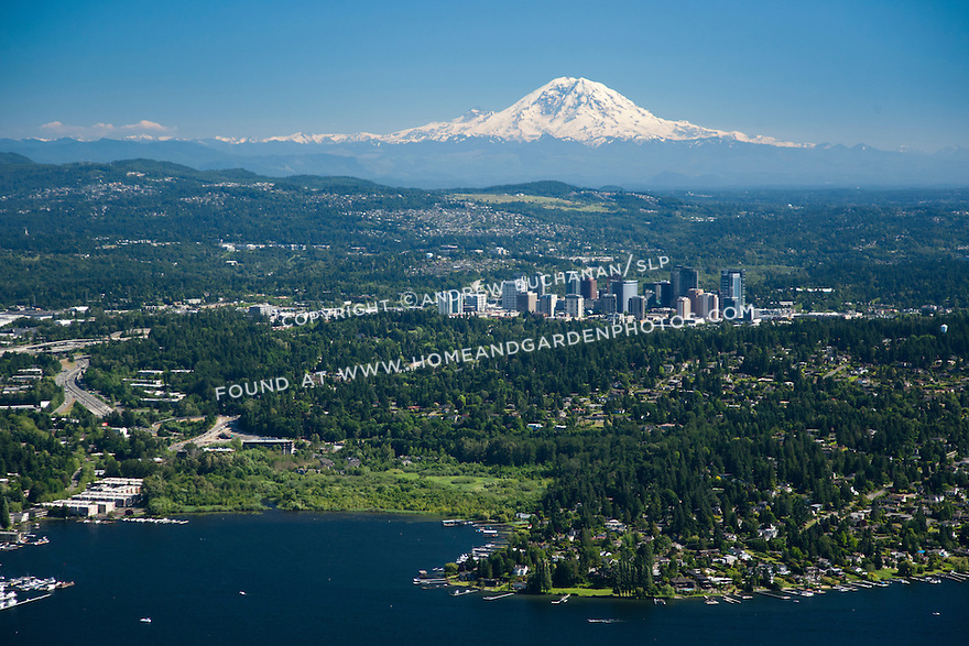 An aerial view of Lake Washington, the skyscrapers of downtown Bellevue, and the snow-capped peak of Mt. Rainier in this iconic image of the Pacific Northwest.