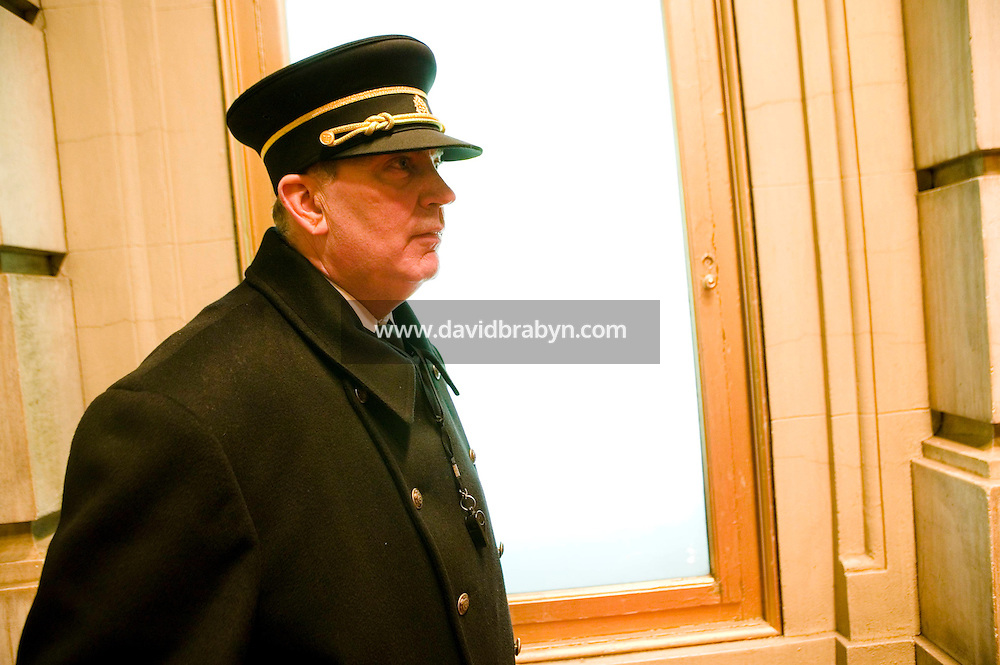 11 January 2006 - New York City, NY - Plaza hotel doorman Ed Trinka awaits visitors in the entrance to the landmark hotel which is currently under renovation, 11 January 2006, New York City, USA. Trinka has been doorman at the Plaza since 1963.