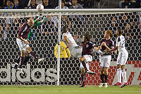 LA Galaxy defender Omar Gonzalez leaps high to head a ball during a cornerkick past Colorado Rapids forward Conor Casey and GK Matt Pickens. The Colorado Rapids defeated the LA Galaxy 3-2 at Home Depot Center stadium in Carson, California on Saturday October 16, 2010.