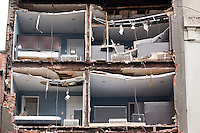 The facade of a building in Chelsea is torn off during Hurricane Sandy seen on Tuesday, October 30, 2012. Hurricane Sandy roared into New York disrupting the transit system and causing widespread power outages. Con Edison is estimating it will take four days to get electricity back to Lower Manhattan. (© Richard B. Levine)