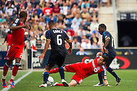 Eric Avila (8) of Toronto FC keeps the ball away from Gabriel Gomez (6) and Freddy Adu (11) of the Philadelphia Union. The Philadelphia Union defeated Toronto FC 3-0 during a Major League Soccer (MLS) match at PPL Park in Chester, PA, on July 8, 2012.