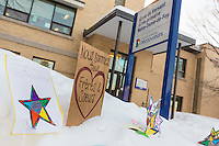 Signs and flowers are seen outside the ecole du Versant  school near the Grande Mosquee de Quebec (Centre Culturel Islamique de Quebec), Thursday February 2, 2017. Sunday January 29, a shooter left six worshippers dead at this Quebec city mosque.