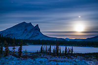 Winter landscape of Mount Sukakpak and the rising full moon, Brooks range, Arctic, Alaska