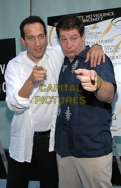 """26 July 2005 - New York, New York - Jeffrey Ross greets Elon Gold as he arrives at the premiere of his new film, """"The Aristocrats"""", at The Directors Guild Theater in Manhattan.  .Photo Credit: Patti Ouderkirk/AdMedia"""