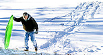 WATERBURY, CT 01 December 2008-010109SV03--Peter O'Neill of Waterbury makes his way back up the hill while sledding at Fulton Park in Waterbury Thursday.<br /> Steven Valenti Republican-American