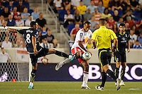 Thierry Henry (14) of the New York Red Bulls and Jermaine Jenas (8) of Tottenham Hotspur F. C. during a Barclays New York Challenge match at Red Bull Arena in Harrison, NJ, on July 22, 2010.