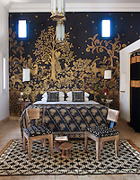 The mural in this guest bedroom was inspired by a screen made by Armand Albert Rateau