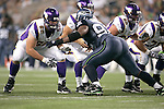 Minnesota Vikings guard Ryan Cook (62) gets set to block Seahawks defensive tackle Chris Clemons (91) at CenturyLink Field in Seattle, Washington August 20, 2011. The Vikings beat the Seahawks  20-7. ©2011 Jim Bryant Photo. All Rights Reserved.