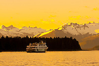 "National Geographic small cruise ship ""Sea Bird"" sailing near Petersburg, with the Boundary Ranges in background, southeast Alaska USA"