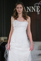 Model walks runway in a Generation wedding dress by Anne Bowen, for the Anne Bowen Bridal Spring 2012 runway show.