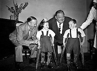 Laurel and Hardy present cheque on behalf of Premier (DOMAS) to Little Willie Fund.22/09/1953..Laurel and Hardy were one of the most popular and critically acclaimed comedy double acts of the early Classical Hollywood era of American cinema. Composed of thin Englishman Stan Laurel (1890-1965) and heavy American Oliver Hardy (1892-1957) they became well known during the late 1920s to the mid-1940s for their slapstick comedy, with Laurel playing the clumsy and childlike friend of the pompous Hardy.[1] They made over 100 films together, initially two-reelers (short films) before expanding into feature length films in the 1930s. Their films include Sons of the Desert (1933), the Academy Award winning short film The Music Box (1932), Babes in Toyland (1934), and Way Out West (1937). Hardy's catchphrase &quot;Well, here's another nice mess you've gotten me into!&quot; is still widely recognized.