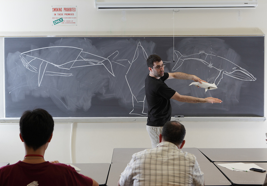 New York, NY, USA - June 26, 2011: Daniel Robinson, original Origami designer at the OrigamiUSA Convention in New York City teaching one of his complex creations, a humpback whale, folded from one square of paper without cuts.